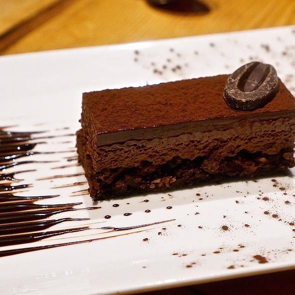 Chocolate torte –espresso biscuit, kahlua ganache, cacao nibs, 65 percent chocolate mousse