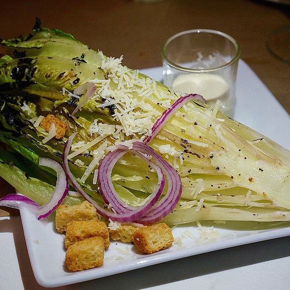 Grilled heart of romaine, parmesan, red onion, herb croutons
