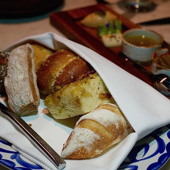 Bread basket –purple potato bread, pain rustic, mushroom francese, saffron sourdough, flamiche, lavender pretzel; pickled peppers, leek caper anchovy oil; herb, goat and honey Oaxacan butters