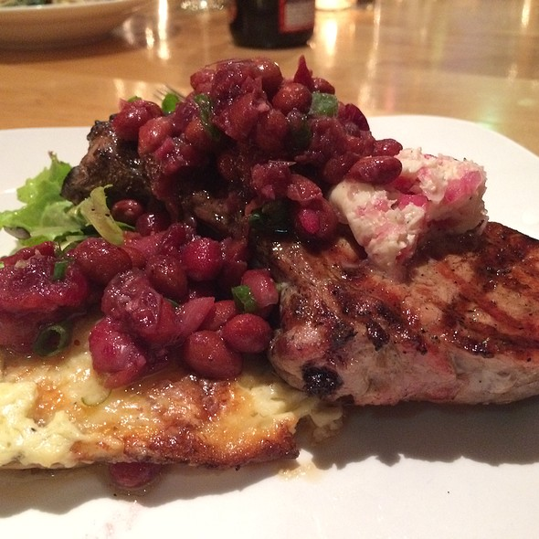 Grilled Vermont Pork Chop with Truffled Cheddar Potato Gratin, Pickled Onion Butter, Raw Greens, and Cranberry Bean Chutney