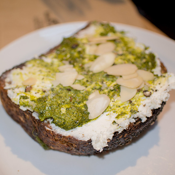 Whole Wheat Everything Bread with Cream Cheese, Pesto, Nuts, Salt, and Pepper