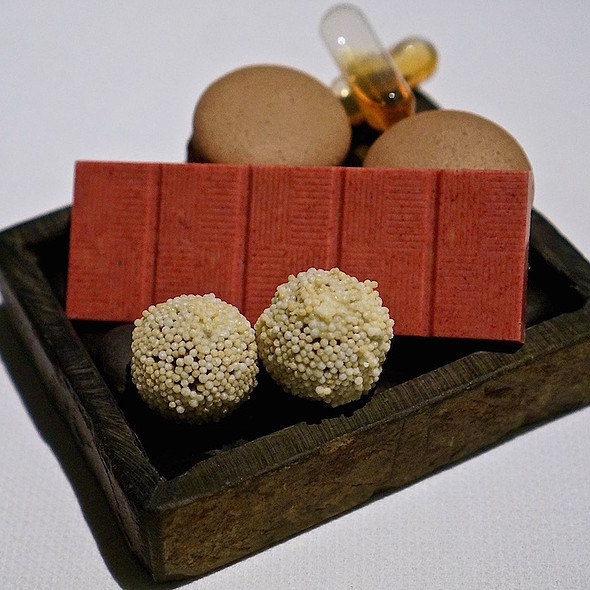 Mignardise – chocolate macarons with Hennessy pipettes, berry pop rocks white chocolate, Grand Marnier chocolate truffles