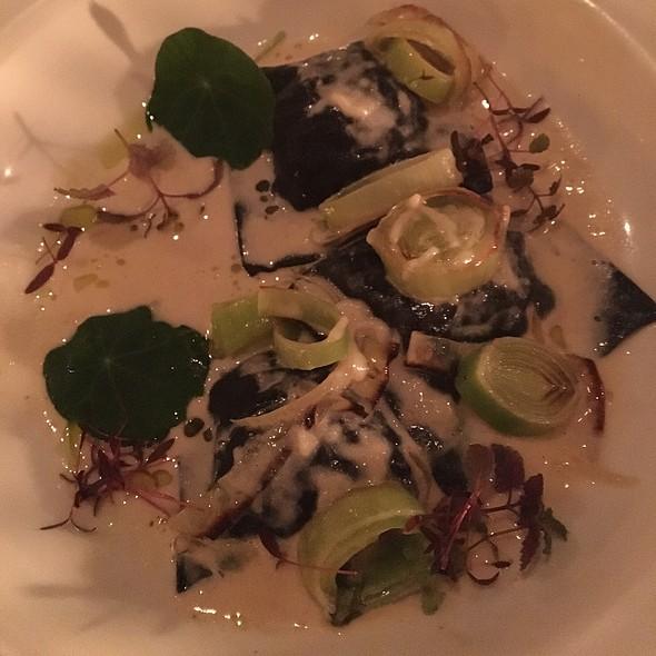 Squid Ink Ravioli, Stuffed With Steelhead Trout In A Creamy Leek Sauce With Microgreens