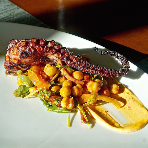 Grilled octopus, chickpea salad, Moroccan olives, stewed sweet peppers, sujuk, aleppo pepper aioli