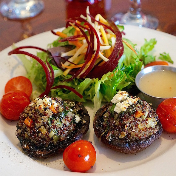 Quinoa stuffed portabello mushrooms, blistered cherry tomatoes, herbed goat cheese