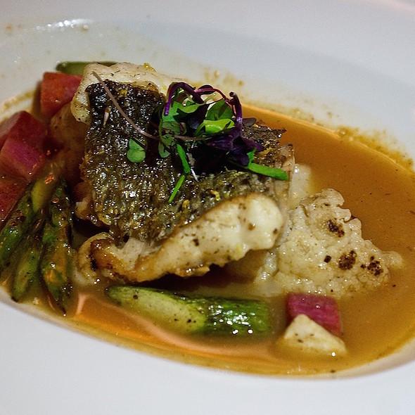 Pan seared striped bass, lobster and lemon balm bouillon, watermelon radishes, cauliflower, asparagus