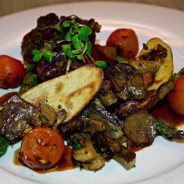 Striploin steak, wild mushrooms, potatoes, asparagus, cherry tomatoes