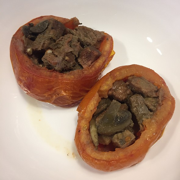 Dolmades with lamb and tomato sauce