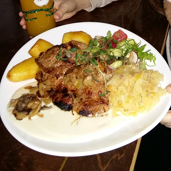 Grilled pork chop with fried onions,mushrooms and sauerkraut