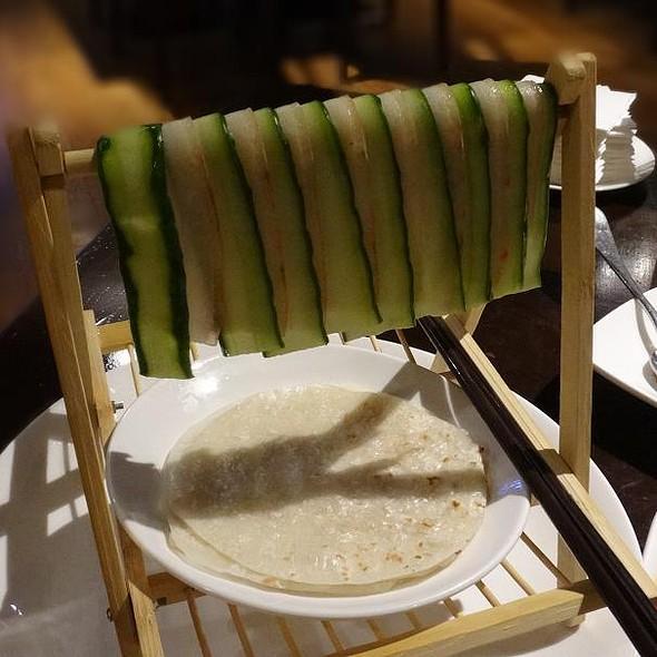Sliced Pork with Cucumber Displayed on Bamboo Rack @ Silk Road Restaurant
