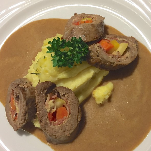 Filled beef rolls, mashed potatoes in caper sauce