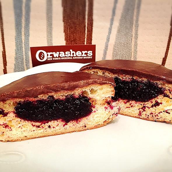 Chocolate Glazed Doughnut with Black Raspberry Filling