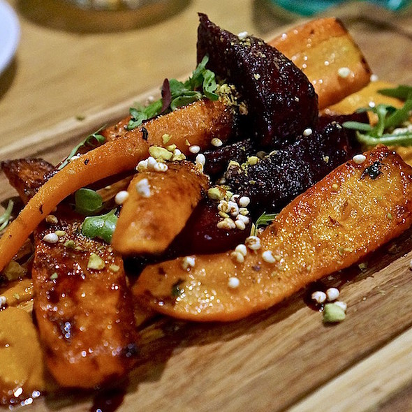 Roasted carrots and beets, romesco, puffed millet, pistachio, birch syrup