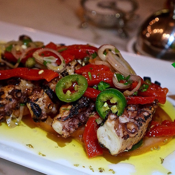Grilled octopus, tomatoes, shallots, roasted bell peppers, jalapeño, capers