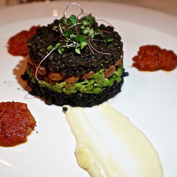 Garden napoleon, forbidden black rice, green peas, beans, beluga lentils, celery root  purée, roasted garlic tomato sauce