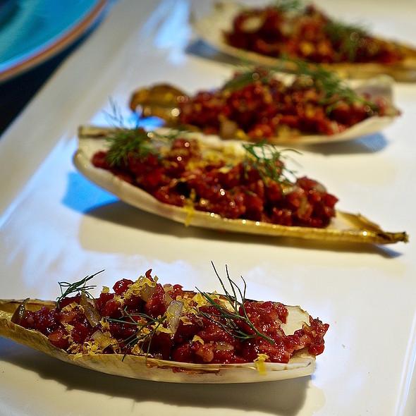 Beef tartare, endive, cranberries, shallots, thyme, salt-cured yolk