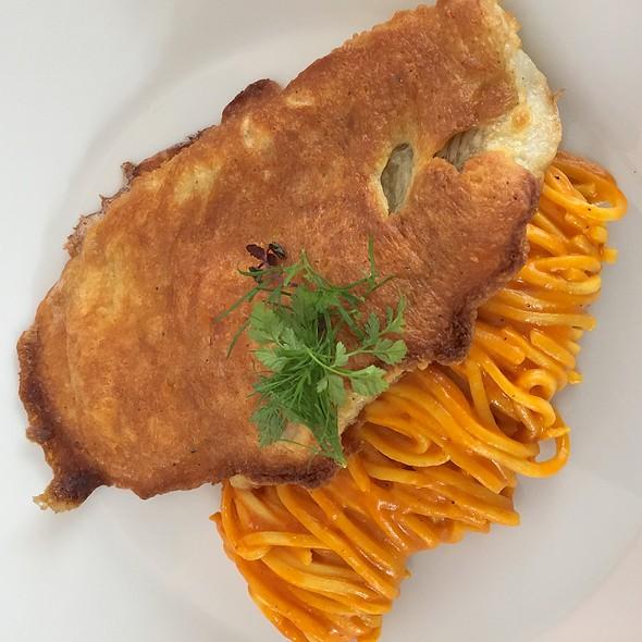 Plaice parisienne with Parmesan. Tomatoe Linguine