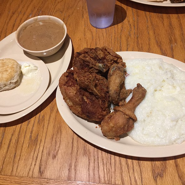 1/2 Chicken With Grits And A Biscuit With Gravy On The Side