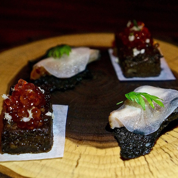 Seaweed chip, smoked eel, radish; trout roe in maple on pumpernickel polenta