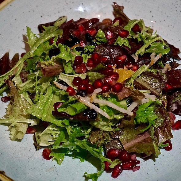 Baby gem lettuce and chicory salad, citrus, Asian pears, pomegranate seeds, currants, pomegranate vinaigrette