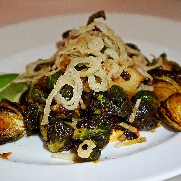 Blistered Brussels sprouts, housemade kimchi, crispy shallots, lime