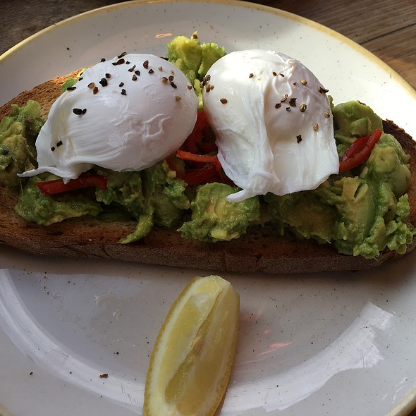Avocado With Chilli On Toast With Poached Eggs