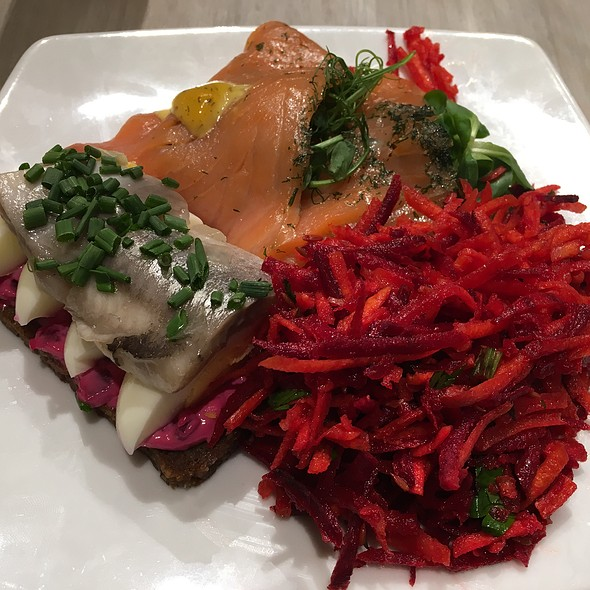 Salmon And Pickled Herring Open Sandwiches With Carrot And Beetroot Salad
