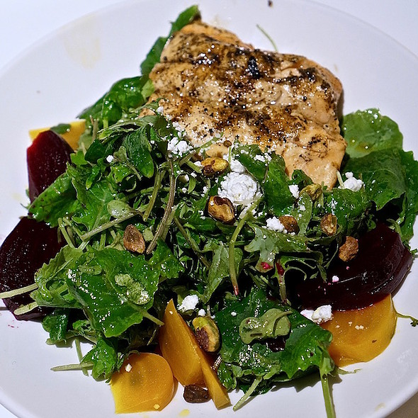 Petite kale salad, pickled beets, Alaskan salmon, ash coated goat cheese, toasted pistachios, rooftop honey rosemary vinaigrette