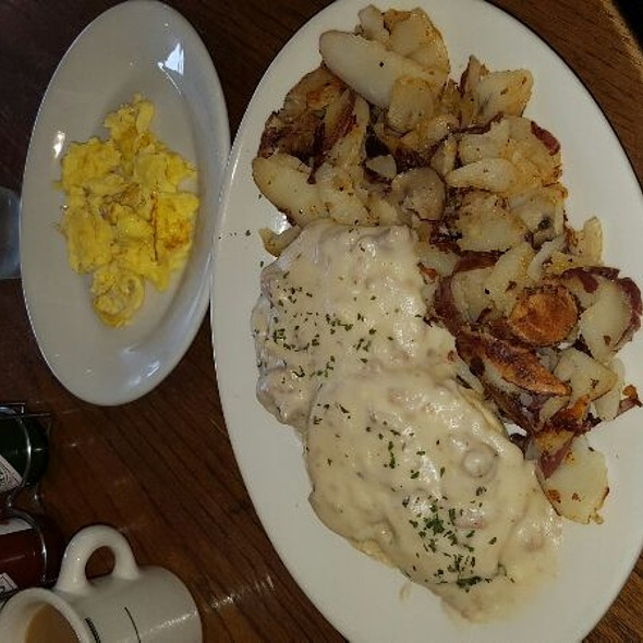 Biscuits & Gravy With Scrambled Eggs And A Side Of Potatoes