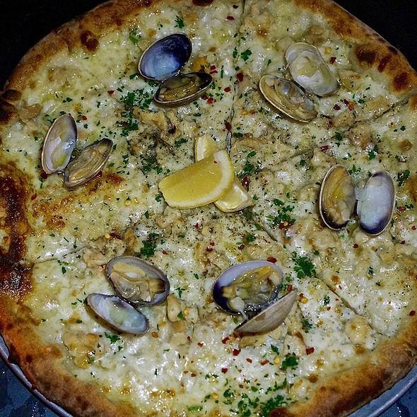 The Pepe pizza – fresh clams, Parmigiano Reggiano, mozzarella, crème fraîche, garlic, shallot, parsley, chili flakes, lemon