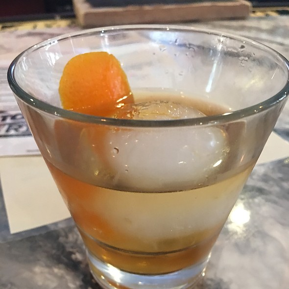 Smoked Old Fashion - Woodford's Reserve Bourbon, Maple Syrup And Angostura Bitters. Hickory-Smoked Served With An Ice Ball.