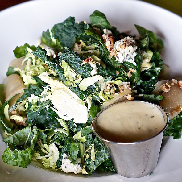 Kale and shaved Brussels sprouts salad, poached pears, candied pecans, Carr Valley gogonzola, champagne vinaigrette