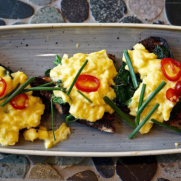 Soft scrambled eggs, spinach, fresno chilies, seeded rye
