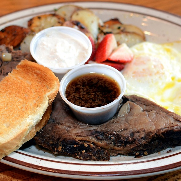 Prime rib with eggs and toast