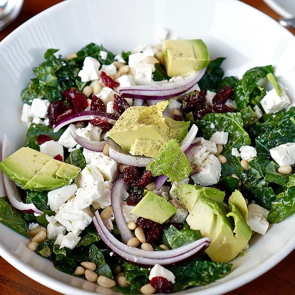 Kale and feta salad, dried cranberries, avocado, red onion, pine nuts, basil and red wine vinaigrette