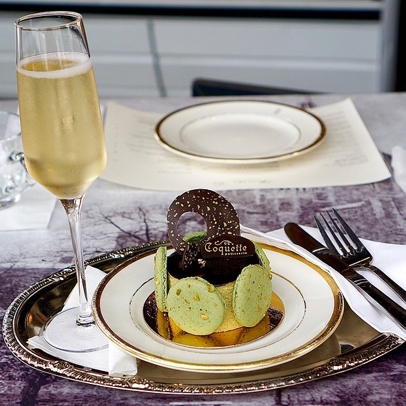 Champagne and pistachio mousse chocolate cake