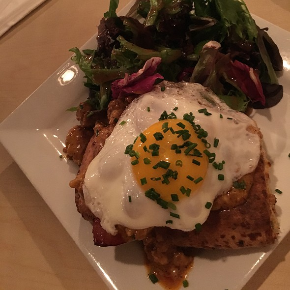 Cheddar Biscuit With Chorizo Gravy, Sunny Side Egg With Mixed Greens @ Dolce Bistro & Bakery