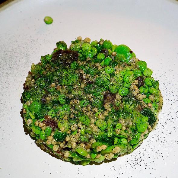 Salad of sprouted grains, fava, peas, fresh chickpeas, rapini, pecorino, chickpea miso vinaigrette