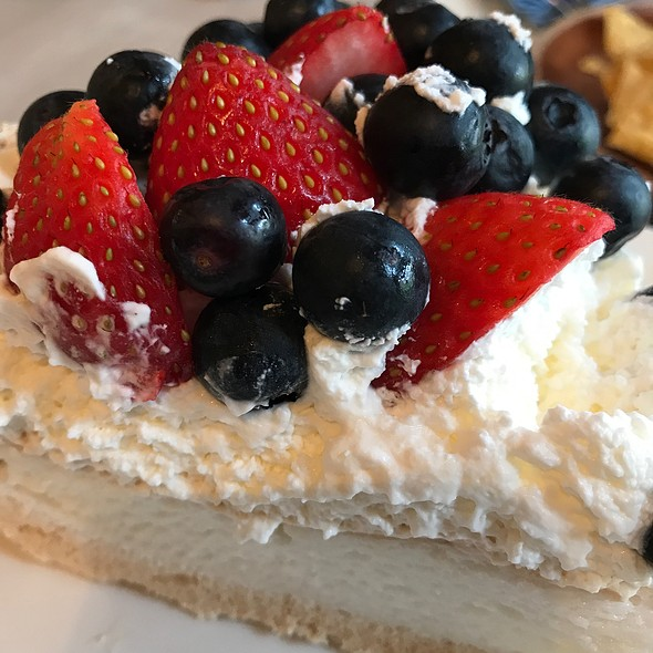Pavlova with lemon mousse and mixed berry compote