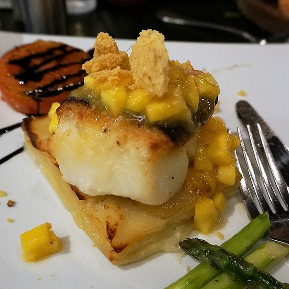 Baked halibut fillet with potato galette, asparagus and mint-mango relish