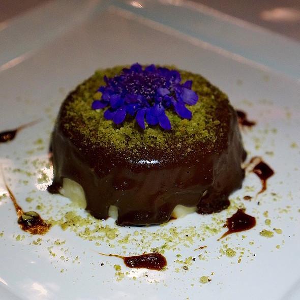 Rosemary panna cotta, chocolate ganache, pistachio crumble