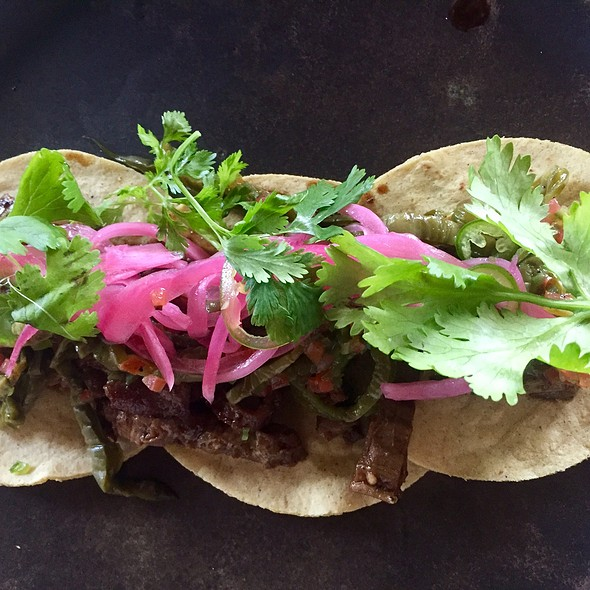 Carne Asada Soft Tacos With Chimole, Black Beans, Toasted Pumpkin Seeds, Pickled Onions, And Cilantro