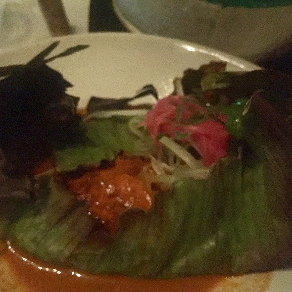 Grouper In Banana Leaf With Achiote Butter, Bitter Orange, Xcatic Pepper, And Leafy Greens