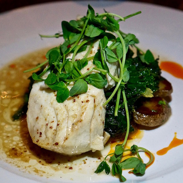 Olive oil poached halibut, confit potatoes, sherry brown butter, grilled citrus kale