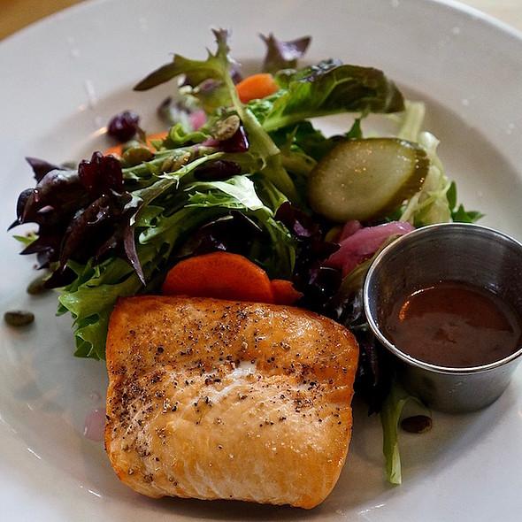 House salad, pickled vegetables, pumpkin seeds, cranberries, grilled wild salmon