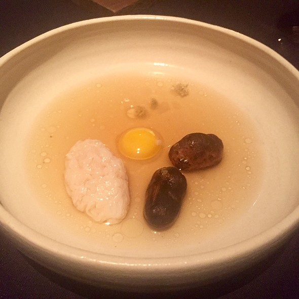 King Crab with Burnt Potatoes and Quail Egg Yolk
