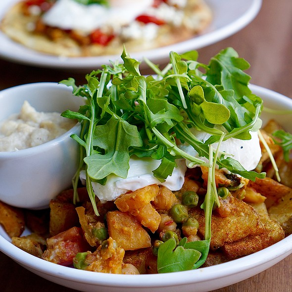 Bangalore hash, curry spiced potatoes, peas, spinach, tomatoes, chickpeas, squash, goat cheese, poached eggs, cauliflower purée 'hollandaise'