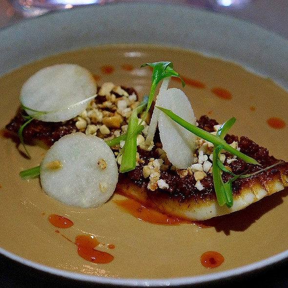 Seared Humboldt squid, peanut, nashi pear, crispy pork chili vinaigrette