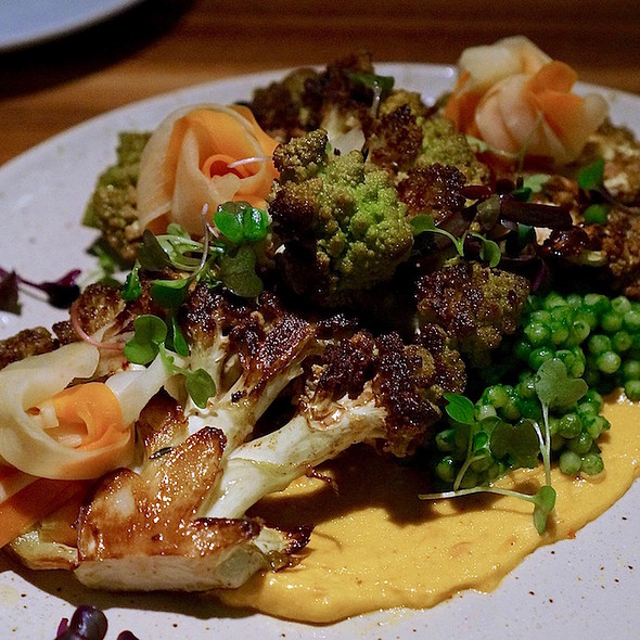 Roasted romanesco, herbed large pearl couscous, pickled root vegetables, harissa aioli