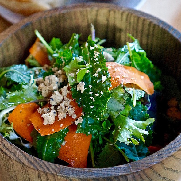 Gathered greens, black vinegar, chili oil, shaved carrot, sesame crumble